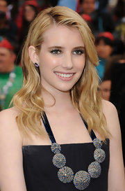 Emma Roberts attended the premiere of 'Pirates of the Caribbean: On Stranger Tides' wearing Emily Sarah earrings in 14-karat black rhodium with amethyst.