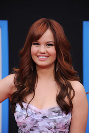 Debby Ryan styled her long red tresses in soft cascading curls for the 'Prom' premiere.