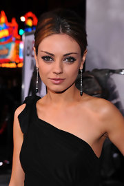 Mila paired her one-shoulder dress and high bun with diamond and onyx drop earrings.