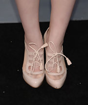 Joey King topped off her flapper-girl look with these blush-colored patent leather booties with peek-a-boo sides.