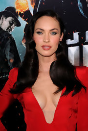 Megan Fox's lips look extra plump in shimmering nude lipstick.