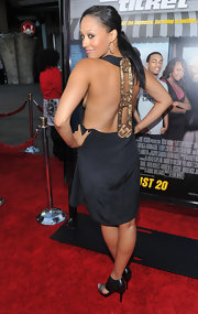 Tia has got back in a daring backless gold number at the premiere of 'Lottery Ticket.'