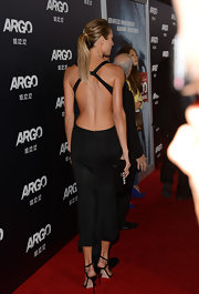 Stacy loves to show off her fierce figure in looks like this black backless number.