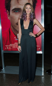 Dawn Olivieri attended the premiere of 'Her' wearing a black jumpsuit with a provocative neckline.