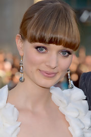 Bella Heathcote opted for Rona Pfeiffer's diamond paved drop earrings to style her white ensemble at the 'Dark Shadows' premiere.