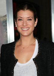 Kate Walsh added gold pendant necklaces to her cropped jacket.