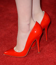 Emma Stone went monochromatic, pairing her red dress with matching Christian Louboutin pumps.