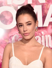 Chloe Bridges styled her hair into a twisted bun for the premiere of 'Isn't It Romantic.'