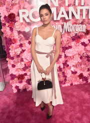 Chloe Bridges looked fetching in a white corset dress with a mauve velvet belt at the premiere of 'Isn't It Romantic.'