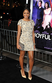 Keke Palmer accessorized her darling textured shift with a gray frame clutch.