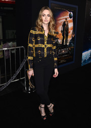 Jamie Clayton attended the 'Jupiter Ascending' premiere wearing a black and yellow Moschino button-down.