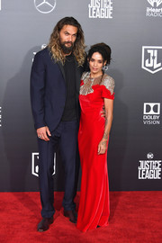 Lisa Bonet looked regal in a red Alexander McQueen column dress with gold eagle embroidery across the yoke at the premiere of 'Justice League.'