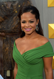 Christina Milian sported a demure half-up hairstyle at the premiere of 'King Arthur: Legend of the Sword.'