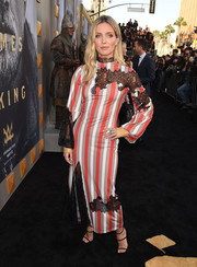 Annabelle Wallis sported a fun play on patterns with this striped, lace-accented dress by Loewe at the premiere of 'King Arthur: Legend of the Sword.'