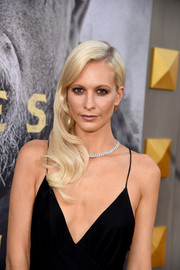 Poppy Delevingne complemented her low-cut dress with a lovely diamond necklace.