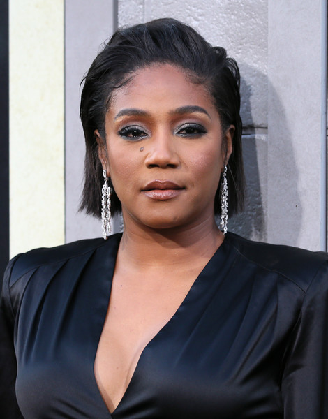 Tiffany Haddish added a dose of glamour with a pair of diamond chandelier earrings.