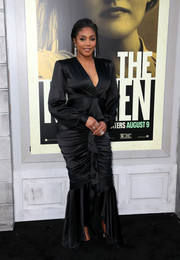 Tiffany Haddish cut a shapely silhouette in a black Galia Lahav gown with a ruched and ruffled skirt at the premiere of 'The Kitchen.'