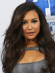 Naya Rivera took her cat eyes to new extremes by lining her lids with a soft silver shadow that brushed up into her lashes.