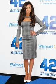 Naya Rivera loves figure-hugging frocks like this gray long-sleeve dress, featuring a neck cutout.