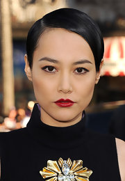 Rinko opted for cherry red lips to give her pout a porcelain doll-like finish.