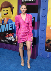 Alison Brie styled her dress with strappy silver platforms by Jimmy Choo.