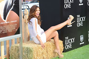 Audrina Patridge paired her short white frock with a pair of beige platform pumps.