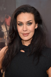 Megan Gale attended the 'Mad Max: Fury Road' premiere wearing her hair in high-volume layers.