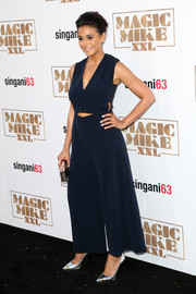 Emmanuelle Chriqui stayed on trend in a navy cutout jumpsuit when she attended the premiere of 'Magic Mike XXL.'