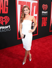 Isla Fisher styled her dress with silver pumps by Brian Atwood.