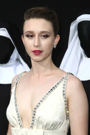 Taissa Farmiga styled her hair into a simple bun for the premiere of 'The Nun.'