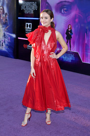 Olivia Cooke stood out in a red Calvin Klein nylon dress with scarf detailing at the premiere of 'Ready Player One.'