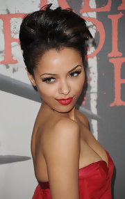 Katerina Graham added major drama to her defined lashes with matte red lipstick.