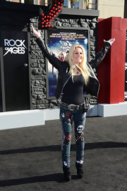 Lita Ford posed at the 'Rock of Ages' premiere wearing a black studded belt with an oversize buckle to top off her heavy metal look.