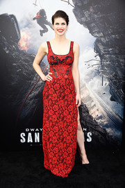 Alexandra Daddario got into a sexy-romantic mood in a red and black lace gown by Diane von Furstenberg for the 'San Andreas' premiere.