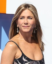 Jennifer Aniston attended the premiere of 'Storks' wearing a pair of dangling earrings by August.