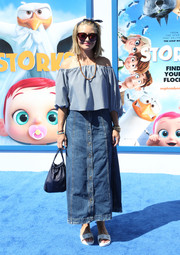 Rebecca Gayheart paired her top with an ankle-length denim skirt.