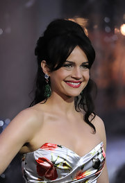 Actress Carla Gugino highlighted her bare neckline by pulling her soft curls up in a half up hairstyle. She parted her bangs down the center which helped frame her face.