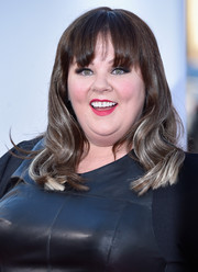Melissa McCarthy kept it youthful with blond-streaked waves and eye-skimming bangs at the premiere of 'Tammy.'
