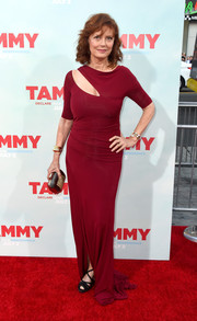 Susan Sarandon styled her dress with an edgy-elegant gold cage clutch.
