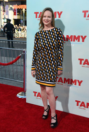 Thora Birch chose a pair of black peep-toe wedges with cross-strap detail to complete her outfit.