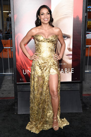 Rosario Dawson was a gilded beauty in a strapless gold sequin gown by Vivienne Westwood Couture at the premiere of 'Unforgettable.'