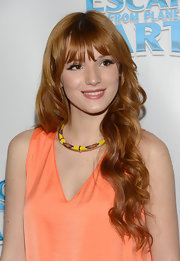Bella Thorne accessorized her dress with a beaded collar necklace.