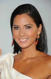 Olivia Munn opted to style her growing bob into a slick and straight 'do that showed off her vibrant coral earrings.