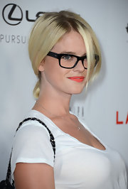 Alice Eve styled her hair in a darling school girl messy ponytail for the 'Lawless' premiere.