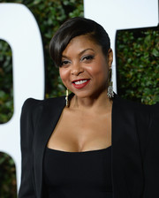 Taraji P. Henson sported a slick ponytail with side-swept bangs when she attended the 'Mandela: Long Walk to Freedom' Hollywood premiere.