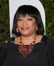 Zindzi Mandela added color and glamour to her look with a gemstone statement necklace when she attended the 'Mandela: Long Walk to Freedom' Hollywood premiere.