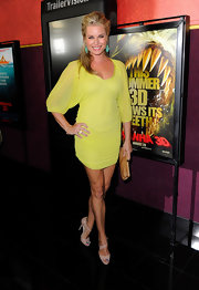 Rebecca looked gorgeous in a vibrant yellow cocktail dress with a sheer overlay.