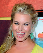 Actress Rebecca Romijn attended the premiere of 'Pirhana 3D' wearing turquoise and diamond Leaf Earrings.