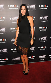 Courteney Cox teamed her lace-hemmed halter dress with black patent Cachet peep-toe platforms.