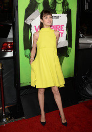 Olga Kurylenko looked youthful and vibrant in a yellow turtleneck dress by Dior during the 'Vampire Academy' premiere.